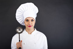 Portrait of young woman chef with spoon Royalty Free Stock Images