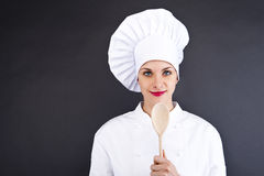 Portrait of young woman chef with spoon Stock Images