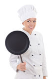 Portrait of young woman in chef uniform with frying pan isolated Stock Images