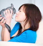 Woman with chinchilla. Portrait of a young woman with chinchilla Royalty Free Stock Image
