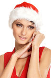Portrait of a young woman in a Christmas hat Stock Images