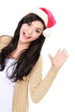 Portrait of young woman in christmas santa hat Royalty Free Stock Photography