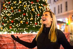 Portrait of young woman on Christmas tree background royalty free stock photography