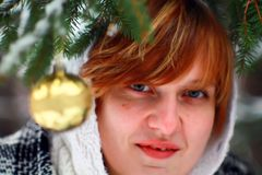 Portrait of Young Woman by Christmas Tree Stock Image