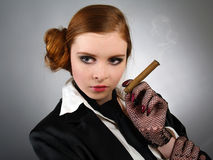 Portrait of the young woman with a cigar Stock Images