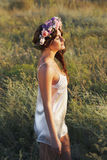 Portrait of young woman with circlet of flowers on head Royalty Free Stock Photo