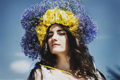 Portrait of young woman with circlet of flowers on head Royalty Free Stock Photos