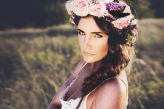 Portrait of young woman with circlet of flowers on head Stock Photos