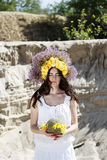 Portrait of young woman with circlet of flowers on head Stock Photo