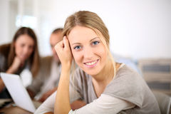 Portrait of young woman in classroom with schoolmates Royalty Free Stock Photo