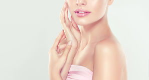 Portrait of young woman with clean fresh skin and soft, delicate make up. Royalty Free Stock Image