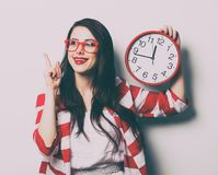 Portrait of the young woman with clock Royalty Free Stock Images