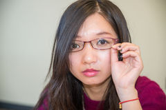 Portrait of young woman. Close portrait of young woman with glasses Stock Photo