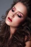 Portrait of a young woman, close-up, bright makeup, eye shadow. Royalty Free Stock Images