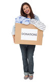 Portrait of a young woman with clothes donation Royalty Free Stock Photo