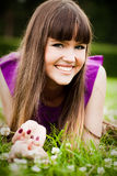Portrait of young woman with clover Royalty Free Stock Photo