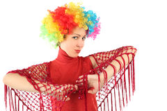 Portrait of young  woman in clown wig and shawl Royalty Free Stock Photos