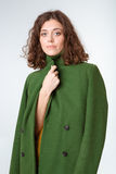 Portrait of a young woman in coat royalty free stock image
