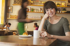 Portrait of young woman at a coffee shop, Beijing Stock Image