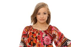 Portrait of young woman in colorful blouse Stock Images