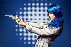 Portrait of young woman in comic pop art make-up style. Female with gun in hand stock illustration