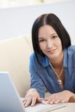 Portrait of young woman with computer Stock Photos