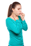 Portrait of an young woman coughing with fist Stock Photo