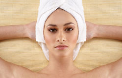 Portrait of a young woman covered with a towel Royalty Free Stock Image