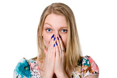 Portrait of young woman covering her mouth with both hands Royalty Free Stock Photos