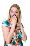 Portrait of young woman covering her mouth with  hand Stock Images