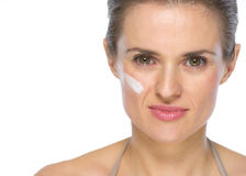 Portrait of young woman with creme on face Royalty Free Stock Image