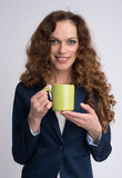 Portrait of young woman with cup Stock Photography
