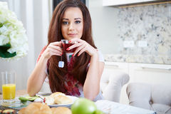 Portrait of young woman with cup Royalty Free Stock Photos