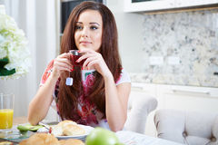 Portrait of young woman with cup Royalty Free Stock Photography