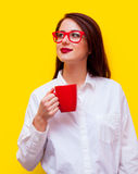 Portrait of a young woman with a cup Royalty Free Stock Images