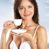 Portrait of a young woman with a cup of coffee Royalty Free Stock Photography