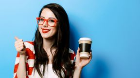 Portrait of the young woman with cup of coffee stock photo