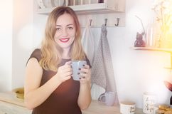 Portrait of young woman with cup stock image