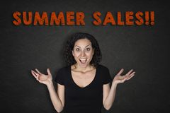 Portrait of young woman with a surprise expression and a `Summer Sales!!` text royalty free stock photography