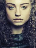 Portrait of young woman with curly hair Royalty Free Stock Photos