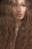 Portrait of young woman with curly hair Royalty Free Stock Image