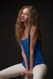 Portrait of young woman with curly hair Stock Photos