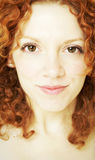 Portrait of young woman with curly red hair. A young woman with curly red hair Royalty Free Stock Photo