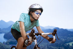 Portrait of young woman cycling over the mountains Royalty Free Stock Photos