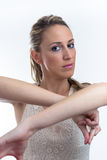 Portrait of young woman dancing with arms raised Stock Photography