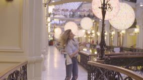 Portrait of young woman dancing in the store stock video