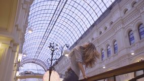 Portrait of young woman dancing in the store stock footage