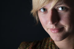Portrait of young woman on dark background Stock Photos
