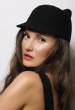 Portrait of Young Woman in Dark Hat Royalty Free Stock Photos