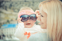 Portrait of young woman with daughter Royalty Free Stock Image